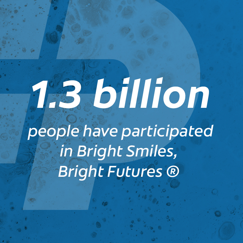 Text reading: 1.3 billion people have participated in Bright Smiles, Bright Futures (Copyrighted)
