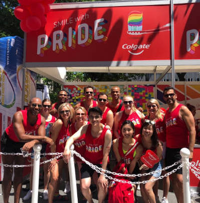 Group of people celebrating Pride and the partnership which was formed with the National Gay, Lesbian, Bisexual, Transgender Chamber of Commerce