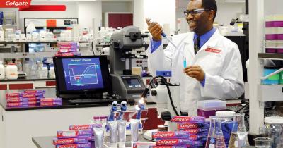 Happy Colgate scientist in his laboratory